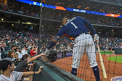 March 26, 2018 - Houston, TX, U.S. - HOUSTON, TX - MARCH 26: Houston Astros infielder Carlos Correa (1) fist bumps a young fan in the front row before warming up to bat during the game between the Milwaukee Brewers and Houston Astros at Minute Maid Park on March 26, 2018 in Houston, Texas. (Photo by Ken Murray/Icon Sportswire) (Credit Image: © Ken Murray/Icon SMI via ZUMA Press)