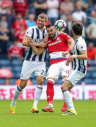 Alvaro Negredo of Middlesbrough is challenged by Gareth McAuley and Claudio Yacob of West Bromwich Albion - Rogan Thomson/JMP - 28/08/2016 - FOOTBALL - The Hawthornes - West Bromwich, England - West Bromwich Albion v Middlesbrough - Premier League.