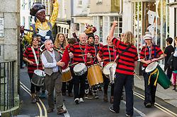Dakadoum Samba Band takes part in the Penryn Festival in Cornwall.