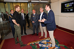 Prince Harry meets Giles (second right) and Nick (right) English of Bremont during the launch of the UK's Invictus Games team at Plaisterers Hall.