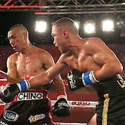 Sergei Lipinets (R) punches Cosme Rivera with a right cross during a Telemundo Boxeo boxing match at the A La Carte Pavilion on Friday,  March 13, 2015 in Tampa, Florida.  (AP Photo/Alex Menendez)