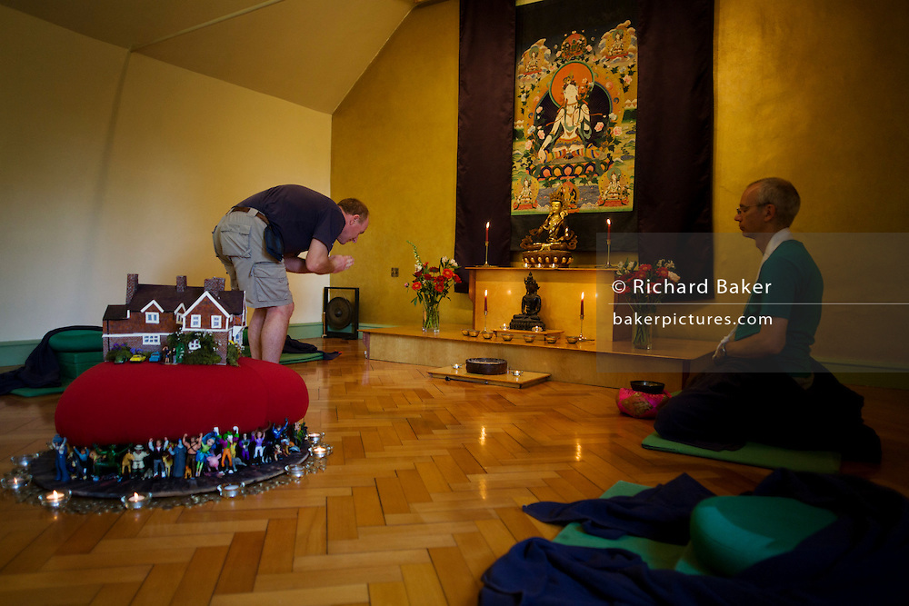 Buddhists after silent meditation for 30 minutes in their Shrine Room at the Rivendell Buddhist Retreat Centre.