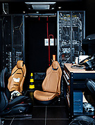 "Maranello, Ferrari HMI, HMI & Ergonomics<br /> team members monitoring<br /> feedback while they carry out<br /> performance tests on the<br /> Maranello simulat,  right: a<br /> ""peek"" at some of the equipment<br /> that makes up the simulator"