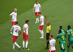 MOSCOW, June 19, 2018  The referee gives a yellow card to Grzegorz Krychowiak (3rd L) of Poland during a Group H match between Poland and Senegal at the 2018 FIFA World Cup in Moscow, Russia, June 19, 2018. (Credit Image: © Wang Yuguo/Xinhua via ZUMA Wire)