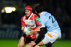 Gloucester Full Back (#15) Rob Cook is challenged by Perpignan replacement (#22) Joffrey Michel during the second half of the match - Photo mandatory by-line: Rogan Thomson/JMP - Tel: 07966 386802 - 12/10/2013 - SPORT - RUGBY UNION - Kingsholm Stadium, Gloucester - Gloucester Rugby v USA Perpignan - Heineken Cup Round 1.