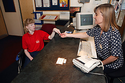 Access to services, Receptionist and disabled woman at the gym reception, Special desk lowered for wheelchair users,