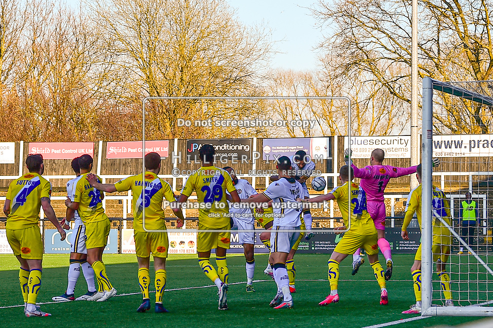 Bromley's Joe Kizzi heads the ball past Altrincham goalkeeper Tony Thompson to score his sides second goal of the match<br /> Bromley | England  | 27 February 2021 | Westminster Waste Stadium<br /> Bromley v Altrincham<br /> Vanarama National League<br /> (Photo: © Jon Hilliger / HilligerPix)