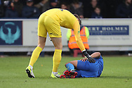 AFC Wimbledon striker Kweshi Appiah (9) down injured during the EFL Sky Bet League 1 match between AFC Wimbledon and Southend United at the Cherry Red Records Stadium, Kingston, England on 24 November 2018.