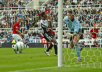 Photo. Andrew Unwin.<br /> <br /> Newcastle United v West Bromich Albion, Barclays Premiership, St James' Park, Newcastle upon Tyne 25/09/2004.<br /> <br /> Newcastle's Patrick Kluivert (C) cannot believe it as another chance narrowly misses the goal.