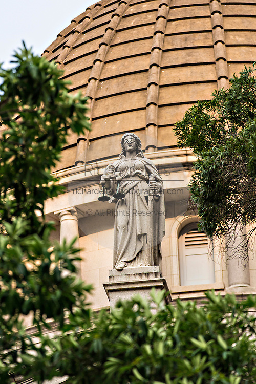 Statue of Themis holding the scales of justice on the Legislative Council Building Central District Hong Kong.