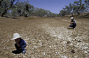 Mark Hinman and his son Thomas on the bank of Combo Water hole during drought in Winton Queensland.
