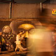Fans pass mural's painted on walls outside the Olympic Stadium after the Fluminense V Ceara,  Futebol Brasileirao League match. Fluminense won the match 3-1. Rio de Janeiro,  Brazil. 8th September 2010. Photo Tim Clayton.