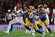 Bengal's tight end Tyler Eifert #85 runs at Rams free safety Marqui Christian #26 during the NFL game between Cincinnati Bengals and LA Rams at Wembley Stadium in London, United Kingdom. 27 October 2019