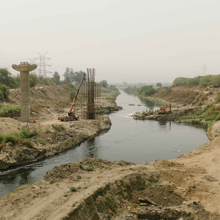 Construction projects next to open sewage.