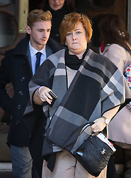 © Licensed to London News Pictures. 17/01/2017. London, UK. Terror attack survivor Owen Richards and mother Suzy Evans leave The Royal Courts of Justice for a lunch break, on the second day of an inquest into the death of 30 Brits in the Tunisia terror attack. The attack took place is Sousse, Tunisia, when Seifeddine Rezgui killed 38 tourists on a beach outside Imperial Marhaba hotel. Photo credit : Tom Nicholson/LNP