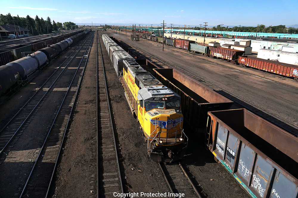 Empty railroad coal cars and railroad tank cars in the Union Pacific Rail yard in Laramie, Wyoming<br /> Photo by Dennis Brack
