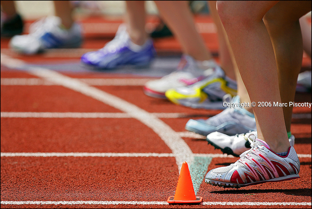 SHOT 5/19/2006 - Girls line up as they prepare for the sound of the starter's gun in the 4A Girls' 1600 Meter Run at the 4A/5A Colorado High School State Track and Field Championships Friday May 19, 2006 at Jefferson County Stadium in Lakewood, Co.