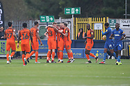 Southend United players celebrating after own goal during the EFL Sky Bet League 1 match between AFC Wimbledon and Southend United at the Cherry Red Records Stadium, Kingston, England on 24 November 2018.
