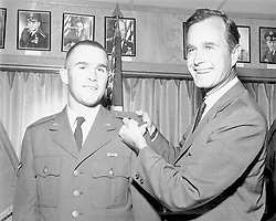 George W. Bush is shown with father George H.W. Bush, then a Houston congressman in this handout photograph. Bush, Sr., is shown pinning on bars signifying his son's commissioning in the Air National Guard as a 2nd Lieutenant circa 1968. Photo via Worth Star Telegram/KRT/ABACA