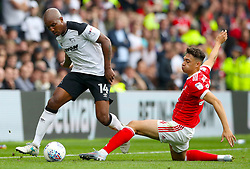 Derby County's Andre Wisdom (left) and Nottingham Forest's Tyler Walker battle for the ball