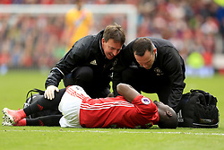 21 May 2017 - Premier League Football - Manchester United v Crystal Palace - Eric Bally of Manchester United receives treatment - Photo: Paul Roberts / Offside