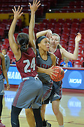March 17, 2016: New Mexico State Aggies forward Tyler Ellis (22) splits a pair of defenders during the first practice day of the 2016 NCAA Division I Women's Basketball Championship first round in Tempe, Ariz.
