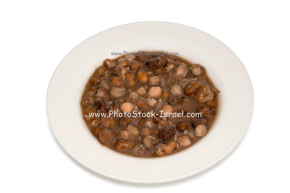 Ful medames an Egyptian breakfast dish of cooked faba beans eaten with bread or pita and onion