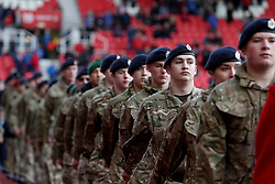 Members of the armed forces on the pitch before the game