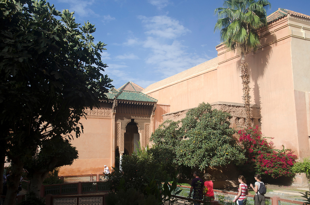People walk in gardens of Saadian tombs Marrakech Morocco