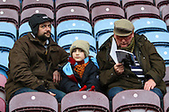 Three generations of Burnley fans get ready to watch the game. Skybet football league Championship match, Burnley v Ipswich Town at Turf Moor in Burnley, Lancs on Saturday 2nd January 2016.<br /> pic by Chris Stading, Andrew Orchard sports photography.