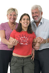 Grandparents with their granddaughter; who has Cerebral palsy,