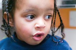 Portrait of a little boy looking puzzled,