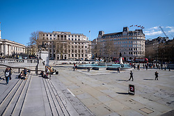 © Licensed to London News Pictures. 12/03/2020. London, UK. Normally full of tourists Trafalgar Square at 2:00PM appears very quiet this afternoon as the World Health Organization declares that the Coronavirus disease is a Pandemic, US President Donald Trump bans all travel from Europe except the UK and Prime Minister Boris Johnson holds a Cobra meeting as fears over the Coronavirus continues. Photo credit: Alex Lentati/LNP