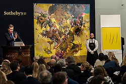 "© Licensed to London News Pictures. 10/02/2016. London, UK.  (L to R) Adrian Ghenie's ""The Sunflowers"" and Lucio Fontana's ""Concetto Spaziale Attese"", which sold for a hammer price of £14.2m and £1.1m respectively, at Sotheby's Contemporary Art evening sale in New Bond Street.   Photo credit : Stephen Chung/LNP"