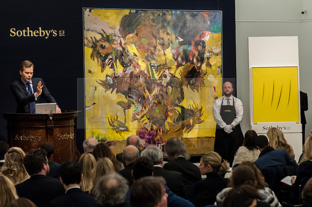 """© Licensed to London News Pictures. 10/02/2016. London, UK.  (L to R) Adrian Ghenie's """"The Sunflowers"""" and Lucio Fontana's """"Concetto Spaziale Attese"""", which sold for a hammer price of £14.2m and £1.1m respectively, at Sotheby's Contemporary Art evening sale in New Bond Street.   Photo credit : Stephen Chung/LNP"""