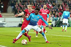 Ainsley Maitland-Niles of Arsenal takes on Frederik Sorensen of Cologne - Mandatory by-line: Robbie Stephenson/JMP - 23/11/2017 - FOOTBALL - RheinEnergieSTADION - Cologne,  - Cologne v Arsenal - UEFA Europa League Group H