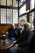 Two friends drink Guinness at ONeills traditional Irish Pub on 04th April 2017 in Dublin, Republic of Ireland. Dublin is the largest city and capital of the Republic of Ireland.