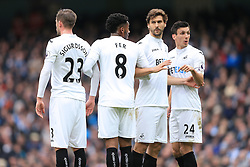 5th February 2017 - Premier League - Manchester City v Swansea City - Fernando Llorente of Swansea (2R) and teammate Jack Cork (R) stand in the defensive wall - Photo: Simon Stacpoole / Offside.