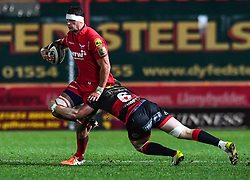Scarlets' Aaron Shingler is tackled by Dragons' Aaron Wainwright<br /> <br /> Photographer Craig Thomas/Replay Images<br /> <br /> Guinness PRO14 Round 13 - Scarlets v Dragons - Friday 5th January 2018 - Parc Y Scarlets - Llanelli<br /> <br /> World Copyright © Replay Images . All rights reserved. info@replayimages.co.uk - http://replayimages.co.uk