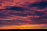 Sunrise skies from Freezeout Lake WMA looking to prairie near Choteau, Montana, USA