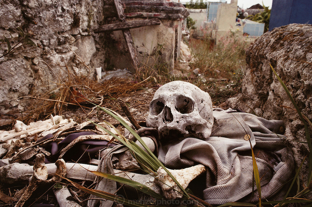 A human skull, bones, and clothing dumped by a grave in  Champoton, Yucatan, Mexico.