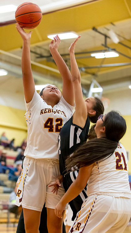 Photo: Jeffery Jones<br /> <br /> Rehoboth Lady Lynx Ashley Skeets (42) shoots the ball over the hands of Menaul School's Mikayla Sierra (2) during Saturday adternoon's varsity girls basketball game at Rehoboth Christian School.