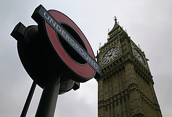 © Licensed to London News Pictures. 08/01/2013, London, UK. Backdropped by Big Ben, an underground sign is seen at Westminster underground station in London, Tuesday, Jan. 8, 2013. London Underground mark its 150 year anniversary on 9 January. In 1863 January 9 the world first underground train entered into public service. Photo credit : Sang Tan/LNP
