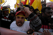 A man punches the air during the march against the genocide in Sri Lanka