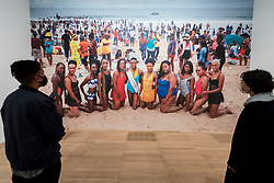 "© Licensed to London News Pictures. 03/11/2020. LONDON, UK. Staff members view ""Brave Beauties, Durban"", 2020, by Zanele Muholi. Preview of the first major UK exhibition by South African visual activist Zanele Muholi at Tate Modern.  260 photographs document black lesbian, gay, trans, queer and intersex lives in South Africa.  The show runs 5 November to 7 March 2021, but will be interrupted by England's coronavirus pandemic lockdown currently due to last 5 November to 2 December. Photo credit: Stephen Chung/LNP"