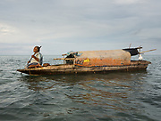 Inda Mula, an old Bajau woman living all year round on a Lepa, a traditional houseboat.