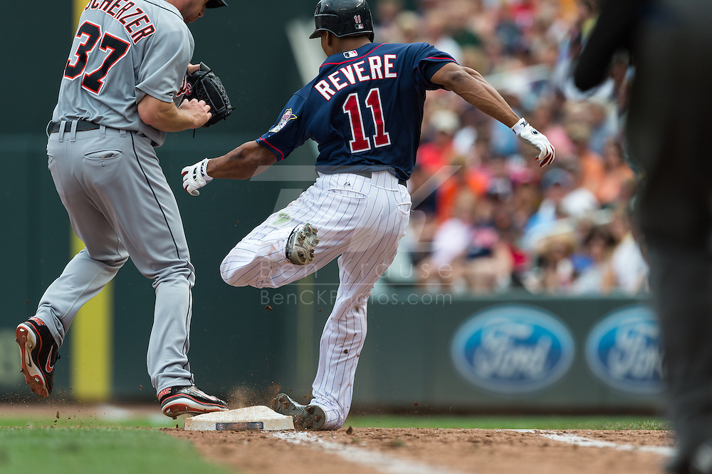 Ben Revere (11) of the Minnesota Twins rolls his ankle on 1st base as Max Scherzer (37) of the Detroit Tigers touches the base first on August 15, 2012 at Target Field in Minneapolis, Minnesota.  The Tigers defeated the Twins 5 to 1.  Photo: Ben Krause