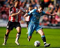 Photo: Alan Crowhurst.<br />Southampton v Sunderland. Coca Cola Championship. 09/04/2007. Southampton's Alexander Ostlund (L) challenges with David Connolly.