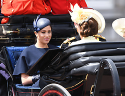 The Duchess of Sussex and The Duchess of Cambridge attending Trooping The Colour, Buckingham Palace, London. Picture credit should read: Doug Peters/EMPICS