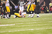 Troy Polamalu 43 (safety) stretches,prays with a teammate and hugs teammates before the New Orleans Saints game as part of his pre game ritual. Polamalu recently had his hair insured for i million dollars during the season because he is the spokesperson for Head and Shoulders shampoo.The New Orleans Saints  beat the Pittsburg Steelers 20-10  in New Orleans at the SuperDome in Louisiana on Halloween Oct.31 2010.Photo©SuziAltman.